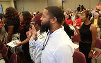"Members of North Texas' latest crop of CPS workers, ""Class V36,"" took an oath of office and heard an upbeat report about their agency's trajectory from their agency's chief Friday. (Rose Baca/The Dallas Morning News)"