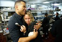 Jordan Roberts consoles Brandi Kenney on the last day of business at the Palm Restaurant in Dallas.(Vernon Bryant/Staff Photographer)