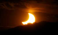 On May 20, 2012, a partial solar eclipse was seen from downtown Denver as the sun set behind the Rocky Mountains.    (David Zalubowski/The Associated Press)