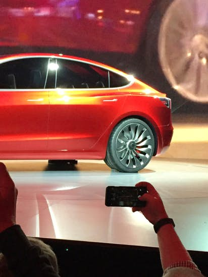 Tesla's more affordable Model 3 begins production Friday, goes on