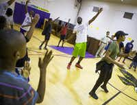 Led by instructor Josh Dumas, students participated in a morning session of Harambee cheers and chants during the Dallas ISD Freedom School summer literacy program at Pease Elementary last Friday.(Staff Photographer/Ryan Michalesko)