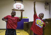 Cody Crawford (left) and Jadean Mathis participate in a morning session of Harambee cheers and chants during the DISD Freedom School summer literacy program at Pease Elementary. (Staff Photographer/Ryan Michalesko)