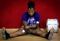 Todja Washington, 18, waits for the Dallas Mass Band practice to begin at the Braswell Child Development Center in Dallas on June 21.(Tailyr Irvine/Staff Photographer)