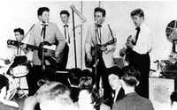 A 15-year-old Paul McCartney making his debut public performance with the Quarrymen  (from left) Colin Hanton (drummer), McCartney (guitar), Len Garry (bass), John Lennon (guitar) and Eric Griffiths (guitar).  ( /(Dallas Morning News file/EPA))