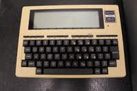 RadioShack introduced the TRS-80 Model 100 portable computer in 1983. The 8-kilobyte version was $599, and the 32-kilobyte went for $1,134 back in the day, according to oldcomputers.net.  It ran on four AA batteries for 16 hours and weighed 3.8 pounds. ( UBid Estate & Auction Services)