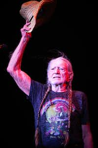 Willie Nelson greets the crowd during the Outlaw Music Festival at the Starplex Pavilion in Dallas on Sunday, July 2, 2017. (Tailyr Irvine/The Dallas Morning News)(Tailyr Irvine/Staff Photographer)
