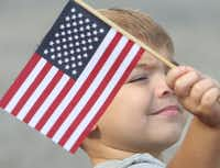 "<p>Alex Medina, 3, of Mansfield, waves an American flag at the 52nd annual 4th of July Parade in Arlington.&nbsp;<span style=""font-size: 1em; background-color: transparent;"">(Steve Hamm/Special Contribut</span><wbr style=""font-size: 1em; background-color: transparent;""><span style=""font-size: 1em; background-color: transparent;"">or)</span></p>"