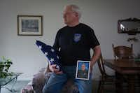 William Ahrens holds a portrait of his son Lorne Ahrens, who was killed in the line of duty as a Dallas police officer a year ago, at his home in Eagle River, Alaska.(Michael Dinneen /Special Contributor)