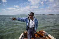 Ansil Saunders, 84, has been bonefishing since 18. Saunders points to where the current world record bonefish was caught by a  client in 1971.(Brian Irwin/Special Contributor)