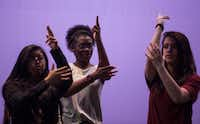 Regina Juarez, 17, left, Trinity Gordon, 17, and Michaela Langford, 17, walk through a scene of <i>Shots Fired</i> on June 30 at Eastfield College in Mesquite. (Ryan Michalesko/Staff Photographer)