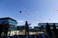 Jim Lentz, CEO of Toyota Motor North America, watches balloons float away during a brief ceremony welcoming employees to the new Toyota North American headquarters in Plano on May 15, 2017. (Vernon Bryant/Staff Photographer)