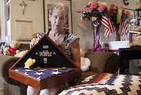 "<p><span style=""font-size: 1em; background-color: transparent;"">Margy Agar received a flag and ribbons at the funeral of her daughter, Kim Agar, who died last October at age 25. Margy made sure Kim was posthumously awarded the Purple Heart for her injuries from an IED attack.</span></p>(Jack White/Staff Photographer)"