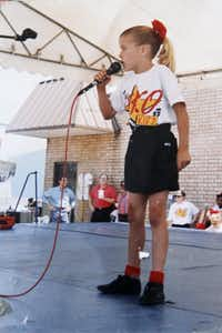"""<p><span style=""""font-size: 1em; background-color: transparent;"""">As a preteen, Kim sang with TKO Kids. Years later, she was selected for the U.S. Army Europe Band &amp; Chorus.</span></p>"""