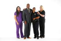From left: Baylor social worker Nita Tarango, DART police Sgt. Homer Hutchins, DART Officer Shamika Sorrells and Baylor emergency nurse manager Sherry Sutton are reunited in the photography studio at <i>The Dallas Morning News</i>. All were photographed together in the doorway of the Baylor emergency room after the July 7 ambush downtown.(Tom Fox/Staff Photographer)