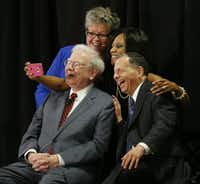 Mirchelle Louis (top left), CEO of Cancer Support Community North Texas, Deanna Dewberry (top right), an NBC 5 consumer investigative reporter, Warren Buffett (bottom left), the CEO of Berkshire Hathaway, and Irv Blumkin (bottom right), CEO of Nebraska Furniture Mart, take a selfie together during the Live Big Benefit for Cancer Support Community North Texas benefit at Nebraska Furniture Mart in The Colony in 2015.(Andy Jacobsohn/Staff Photographer)