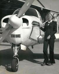 Argyle resident Beverley Bass is pictured here with the 1953 Beechcraft Bonanza she used to carry bodies for a mortician. It was her first paying job as a pilot.(Courtesy photo)
