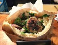 A lamb kebab sandwich at Miznon, an Israeli sandwich shop in the Marais(Leslie Brenner/Staff)