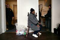 Gloria Rhodes, 64, watches as employees of Eagle Moving and Storage Company remove the furniture and belongings from the apartment she shared with her daughter, Ara Sparkman in Milwaukee, Wis., in February 2010. Here and in swaths of many cities, evictions from rental properties are so common that they are part of the texture of life. But new research is showing that eviction is a particular burden on low-income black women, often single mothers, who are more likely than men to rent apartments and more vulnerable to losing them, in part because their wages or welfare payments have not risen with the cost of housing. And evictions can easily throw families into cascades of turmoil and debt. (Sally Ryan/The New York Times)(SALLY RYAN/NYT)