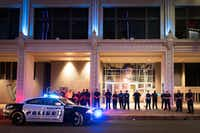 At 8:58 p.m. Friday, a year to the minute after the ambush, Dallas police joined Dallas County Community College District officers for a moment of silence where the shooting began outside El Centro College.(Smiley N. Pool/Staff Photographer)