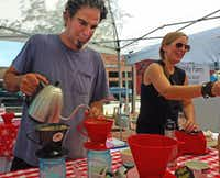 Home-based roaster Drake Tenorio from Rowlett Coffee Roastery shares his love of fresh-roasted  and brewed coffee with Rockwall Farmers Market shoppers. His wife, Aprille, helps him. (Kim Pierce)