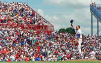 Nolan Ryan tipped his hat to the fans as his career was winding down, along with the life of Arlington Stadium.(File Photo/Staff)