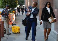 Dallas County Commissioner John Wiley Price, left, and co-defendant Dapheny Fain walk into the Earle Cabell Federal Building and Courthouse in April during their trial.(David Woo/Staff Photographer)