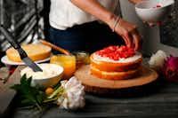 Local baker Kristen Massad demonstrates how to make a naked layer cake.(Tom Fox/Staff Photographer)