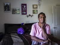 Debra Cavett poses for a portrait in her apartment on Tuesday, July 21, 2015 at Millennium apartments in McKinney, Texas.  Cavett is a Section 8 voucher holder who moved from Dallas to Millennium, where 130 of 164 units are reserved for low-income residents(Ashley Landis/Staff Photographer)