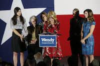 Gubernatorial candidate Wendy Davis cried as she talked about her supporters during an election night watch party at Times Ten Cellars in Fort Worth on Nov. 4, 2014.  She is pictured with her daughter Dru Davis, mother Ginger Russell,  sister Jennifer James,  brother Joey Russell and daughter Amber Davis. (File Photo/Staff )