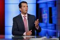 Donald Trump Jr. was interviewed by host Sean Hannity on his Fox News Channel television program in New York on Tuesday.  (Richard Drew/The Associated Press)