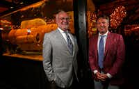 Nick Badovinus (right) and his father, Wayne, pose next to a yellow Cold War minesweeper at Town Hearth. The son and father own Flavorhook, a growing mini-empire of hip restaurants .(Jae S. Lee/Staff Photographer)