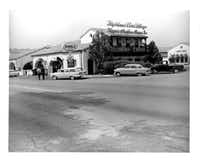 The site of the 3-story building with the club on top was originally a service station.(Highland Park Village)