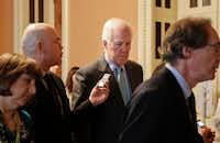 Senate Majority Whip John Cornyn of Texas was pursued by members of the media as he walked the hallway on Capitol Hill in Washington on Thursday.  It's Cornyn's job to line up Republican votes.(Pablo Martinez Monsivais/The Associated Press)