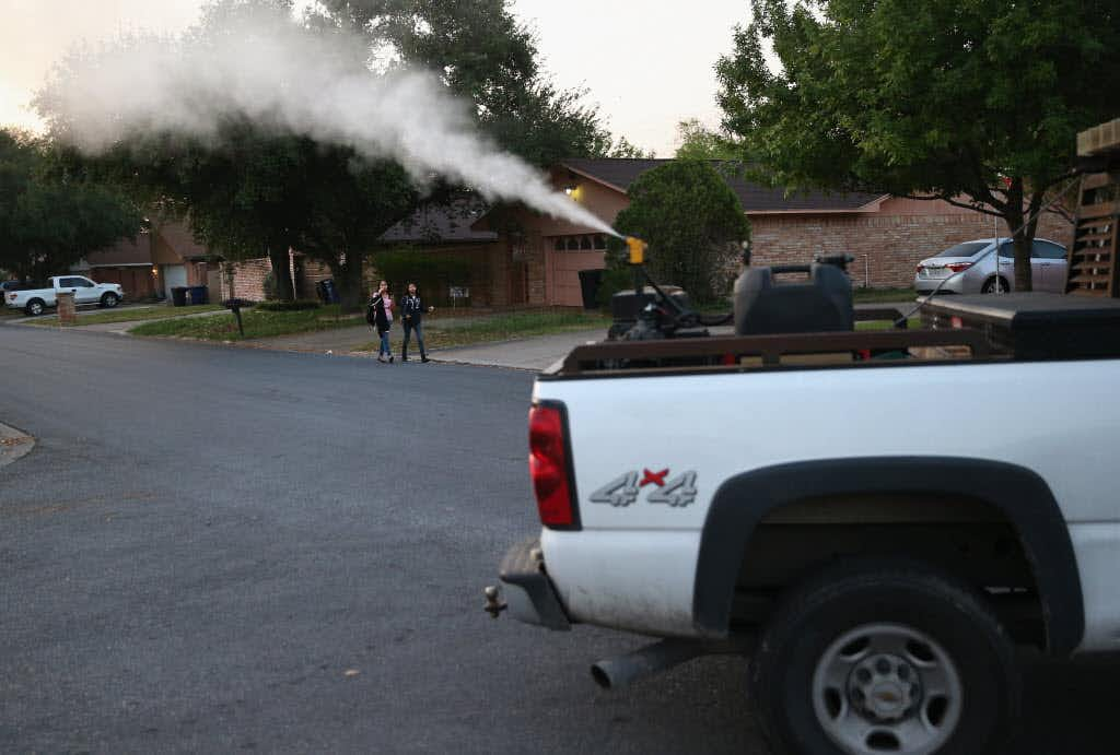 <p>Currently, counties around Texas, including Dallas County, use ground spraying of insecticides to control mosquito populations and protect against mosquito-borne diseases like Zika and West Nile virus. Here, a neighborhood in McAllen is sprayed for mosquitoes early on April 14, 2016.</p>(John Moore/Getty Images)