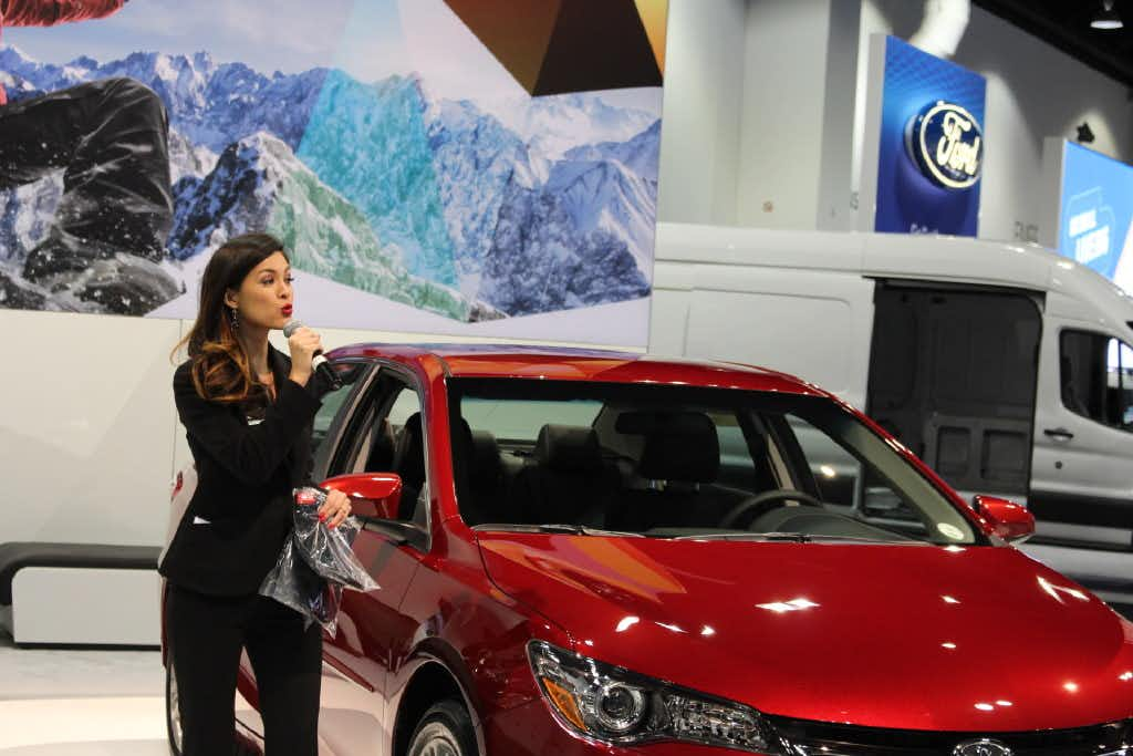 Isabelle Du, a Production Plus employee, talks about a Toyota at the Denver Auto Show in April, 2017.(Courtesy of Production Plus - The Talent Shop)