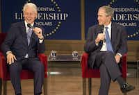 Former Presidents George W. Bush and Bill Clinton joke back and forth during Thursday's Presidential Leadership Scholars Graduation at the George W. Bush Presidential Center in Dallas. (Ryan Michalesko/Staff Photographer)