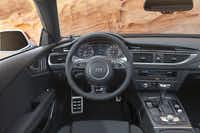 After the RS 7 starts, an iPad-size screen flips out from the middle of the dashboard that includes information on navigation, audio and other systems.
