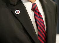 "<p>Lt. Gov. <a name=""firsthit"" id=""firsthit""></a>Dan Patrick wears one of the ""20 for 20"" pins Gov. Greg Abbott has been distributing, indicating a&nbsp;determination to pass all 20 items on Abbott's call for the special session.</p>(Deborah Cannon/Austin American-Statesman)"