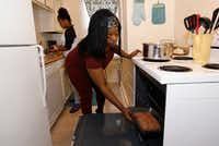 Ebony Green, right, prepares meatloaf with her daughter Amaris Dobbins, 13, in their apartment on Thursday, June 8, 2017 in Dallas. (David Woo/The Dallas Morning News)