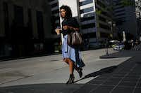 Dominique Wade,  an assistant buyer at Neiman Marcus, walks along Commerce Street on  July 7. (Andy Jacobsohn/Staff Photographer)