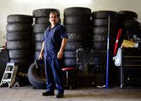 Joaquin Godinez poses at his auto mechanic shop in southeast Dallas.((Ben Torres/Special to The Dallas Morning News))