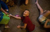 """Isaac Singleton, 12, of Murphy plays the game """"Ninja"""" on July 7, 2017, in Little Elm. Isaac has a brother, Evan, who is transgender.(Ryan Michalesko/Staff Photographer)"""