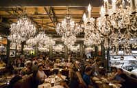 Chandeliers decorate the dining room at Town Hearth restaurant on Thursday, April 20, 2017 on Market Center Blvd. in Dallas. (Ashley Landis/The Dallas Morning News)
