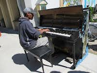 Downtown Mobile is a music hotspot. Here, a musician named Keith plays at a piano by the Lost Garden in LoDa, the Lower Dauphin Street district.(Robin Soslow)