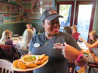 Miss Pinky serves up fried green tomatoes, masterly bloody marys and other zesty fare at Wintzell's, a famous spot in downtown Mobile, Ala. (Robin Soslow)