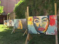 Paintings by locally based artists are displayed in the Lost Garden on Dauphin Street in downtown Mobile, Ala. (Robin Soslow)