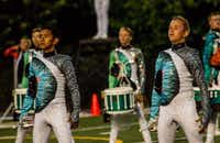 David Johnson (right) performs with the Blue Knights in uniform. (Tony Villalobos-May/Ascend Performing Arts)