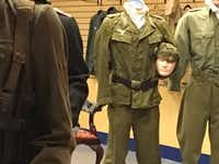 One of the last few years' efforts to re-purpose Valley View Mall, a privately owned World War II exhibit. Last week, it was a fenced-off collection of uniformed mannequins, including a Luftwaffe officer cradling his head under one arm.(Jacquielynn Floyd/DMN)