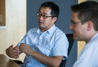 UT-Arlington associate professor of computer science and engineering Chengkai Li (left) and associate professor of computer science and engineering Christoph Csallner talk about how to identify fake news.(Ashley Landis/Staff Photographer)