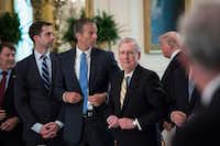 From left, Sens. Tom Cotton, R-Ark., John Thune, R-S.D., and Mitch McConnell, R-Ky., stand as President Donald Trump arrives for a meeting with Republican senators about health care in the East Room of the White House. (Jabin Botsford/The Washington Post)